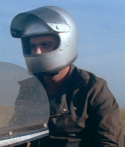 "Bubba with his silver full-face helmet (possibly a Bell ""Star"" helmet)."